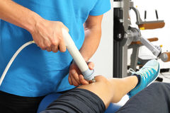 Neurological rehabilitation. Physiotherapist doctor performs surgery on a patient's leg Stock Images