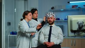 Neurological researchers explaning treatment result