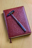 A neurologist`s notebook on the table. Leather notebook of the neurologist on the table with a medical tool stock images