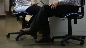 Neurologist testing knee reflex of male patient stock video