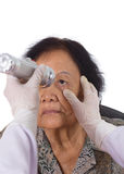 Neurologist testing reflexes of the eye of young woman Stock Photo