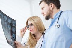 Free Neurologists Reading Brain MRI Stock Photography - 49942252