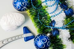 Neurology or Neuroscience Christmas and New Year with decorations. Neurological rubber reflex hummer and figure or brain lying nea. R artificial snow with stock images