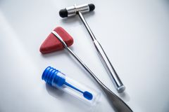 Neurology reflex hammer and stool sample tube for multiple sclerosis research or examination stock photography