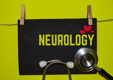 NEUROLOGY on top of yellow background. A stethoscope and blackboard with word NEUROLOGY on top of yellow background. Medical, health and education concepts stock images