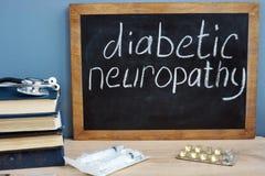 Neuropatia do diabético escrita à mão em um quadro-negro fotografia de stock royalty free
