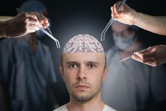 Neuroscience and neurosurgery concept. Surgeons during operation of brain