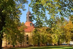 Park with culture church St. Marien in Neuruppin Germany. Neuruppin, Brandenburg/ GERMANY November 01 2014: autumn time in park of Neuruppin Brandenburg. In stock image