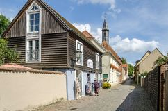 Street Siechenstrasse with old buildings in Neuruppin, Germany. Neuruppin, Germany - 28 August, 2017: Street Siechenstrasse with old wooden and red bricks Royalty Free Stock Images