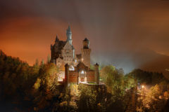 Neuschwanstein. Night view over Neuschwanstein castle in Bavarian Alps Royalty Free Stock Photo