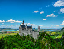Neuschwanstein. Bavarian castle Neuschwanstein in the Alps royalty free stock photo