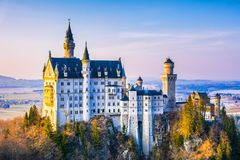 Neuschwanstein, beautiful fairytale castle near Munich in Bavaria, Germany, with colorful trees. royalty free stock photos