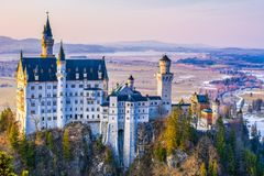 Neuschwanstein, beautiful fairytale castle near Munich in Bavaria, Germany, with colorful trees. royalty free stock photography