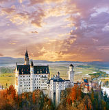 Neuschwanstein, beautiful fairytale castle near Munich in Germany. Neuschwanstein, beautiful fairytale castle near Munich in Bavaria, Germany, with colorful Stock Photos