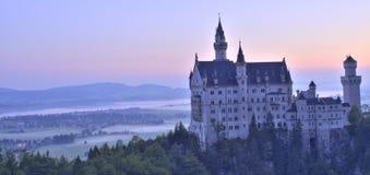 Neuschwanstein castle. The sunset near Neuschwanstein castle Stock Photos