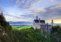 Neuschwanstein castle. Early morning over a famous castle Neuschwanstein in Germany Royalty Free Stock Images
