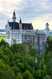 Neuschwanstein castle. Early morning over a famous castle Neuschwanstein in Germany royalty free stock photography