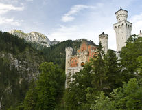 Neuschwanstein castle. Early morning over a famous castle Neuschwanstein in Germany Stock Photo