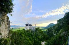 Neuschwanstein castle. Early morning over a famous castle Neuschwanstein in Germany perched on a hilltop stock photography