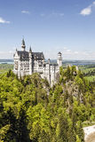 Neuschwanstein Castle above the forest Stock Images