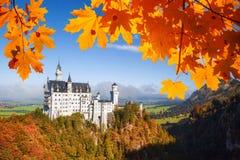 Neuschwanstein castle with autumn leaves in Bavaria, Germany Stock Photos