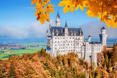 Neuschwanstein castle with autumn leaves in Bavaria, Germany Stock Photo