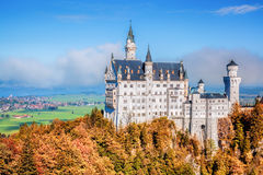 Neuschwanstein castle with autumn trees in Bavaria, Germany Stock Image