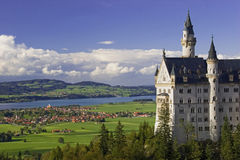 Neuschwanstein Castle in Bavaria, Germany. Closeup of King Ludwig II, Neuschwanstein Castle in Bavaria, Germany with vibrant country side Stock Photos