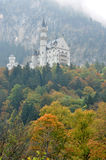 Neuschwanstein castle. In Bavaria, Germany in fall; view from the ground Royalty Free Stock Image