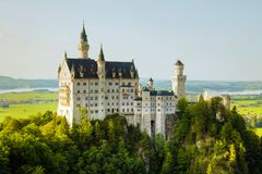 Neuschwanstein castle in Bavaria, Germany. On a sunny day royalty free stock image