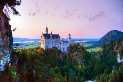 Neuschwanstein castle in Bavaria, Germany. At sunset stock photography