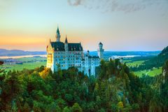 Neuschwanstein castle in Bavaria, Germany. At sunset royalty free stock images