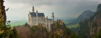Neuschwanstein castle in Bavarian alps. Panoramic view of Neuschwanstein castle in Bavarian alps, Germany Royalty Free Stock Photos