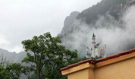 Neuschwanstein Castle in the fog Royalty Free Stock Photos