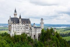 The Neuschwanstein castle in Fussen Germany. Schloss Neuschwanstein. New Swanstone Castle . Summer landscape - view of. The famous tourist attraction in the royalty free stock image