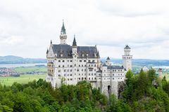 The Neuschwanstein castle in Fussen Germany. Schloss Neuschwanstein. New Swanstone Castle . Summer landscape - view of the famous tourist attraction in the royalty free stock image