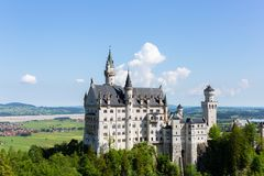 The Neuschwanstein castle in Fussen Germany sunny day. Schloss Neuschwanstein. New Swanstone Castle . The Neuschwanstein castle in Fussen Germany. Schloss royalty free stock photography