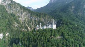 Neuschwanstein Castle Germany Alps Aerial 4k. Aerial footage of a beautiful castle in the Bavarian alps in Germany called Neuschwanstein. This is in 4k quality stock video footage
