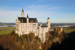 Neuschwanstein Castle in Germany. The background is Bavarian Alps region royalty free stock photography