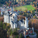 Neuschwanstein Castle in Germany. The background is Bavarian Alps region Royalty Free Stock Image
