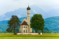 Neuschwanstein Castle in Germany and church near Stock Photography