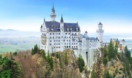 Neuschwanstein Castle in Germany. Panorama of Neuschwanstein Castle in Germany stock photo
