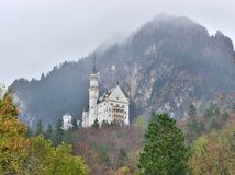Neuschwanstein castle in Germany. View with mountains. Raining frog mood Royalty Free Stock Photos