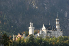 Neuschwanstein castle on the hills royalty free stock photos