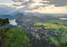 Neuschwanstein Castle and Hohenschwangau at sunset Stock Photos