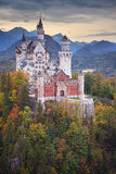 Neuschwanstein Castle. Image of the Neuschwanstein Castle surrounded with autumn colours during sunset Stock Image