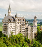 Neuschwanstein Castle located near Fussen in southwest Bavaria, Germany. Neuschwanstein Castle is a nineteenth-century Romanesque Revival palace on a rugged Stock Photography