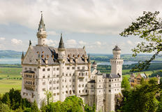 Neuschwanstein Castle located near Fussen in southwest Bavaria, Germany. Neuschwanstein Castle is a nineteenth-century Romanesque Revival palace on a rugged Royalty Free Stock Photos