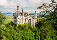 Neuschwanstein Castle located near Fussen in southwest Bavaria, Germany. Neuschwanstein Castle is a nineteenth-century Romanesque Revival palace on a rugged Royalty Free Stock Photo