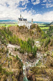 Neuschwanstein castle located in Schwangau, Germany. Schangau, Germany - May 3: Neuschwanstein castle on a cloudy day in Schwangau, Germany Stock Photo